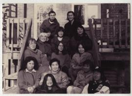 GROUP PORTRAIT: STAFF OF MONTREAL BULLETIN POSE FOR PHOTO ON BACK-STAIRS OF MONTREAL HOME