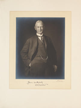 Portrait of F. N. G. Starr, 3/4 length, standing, full face, left hand in pocket